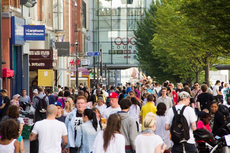 The University and Manchester City Shoppers on Manchester's Market Street
