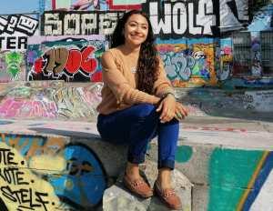 Karen Garcia-Rodriquez sitting on a wall.